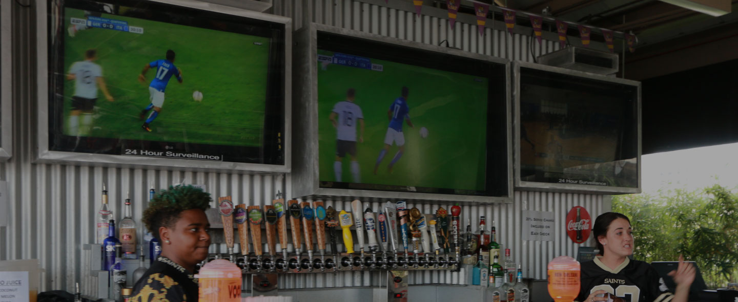 Huge TVs and ice cold beer on tap at Time Out Sports Bar & Grill in New Orleans, LA